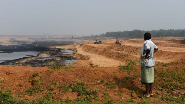 A Gonds tribesman looks over central India's Parsa East and Kante Basan coal mine. Operated by Adani, the mine has had a ...