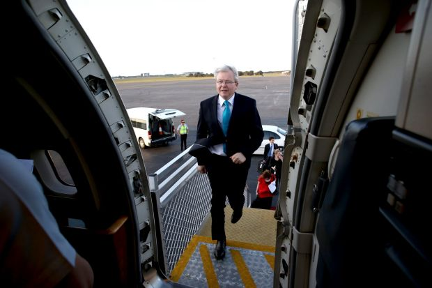 Lights, camera, action: Prime Minister Kevin Rudd runs onto his jet after the ALP campaign launch in Brisbane on ...