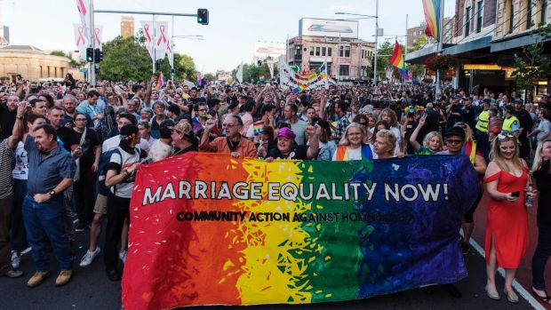 "Crowds march down Oxford Street, Darlinghurst, to celebrate the ""yes"" vote."