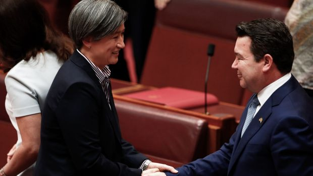 Labor's Penny Wong congratulates Smith after his speech.