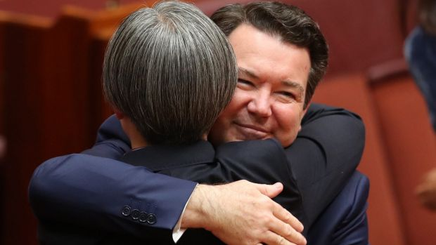 Senator Penny Wong is hugged by co-sponsor Senator Dean Smith after speaking on the Marriage Amendment Bill at ...