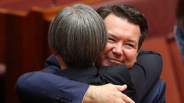 Senators Dean Smith and Penny Wong hug after speaking on the Marriage Amendment Bill on Thursday.