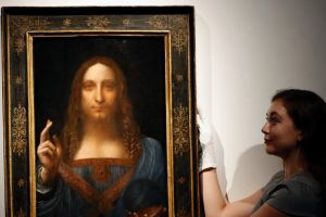 An employee with Leonardo da Vinci's Salvator Mundi  on display at Christie's auction rooms, in London.