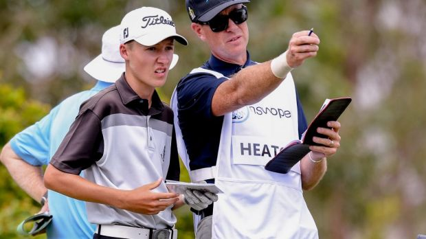 Thomas Heaton consults with his caddy.