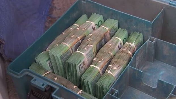 Cash seized by strike force investigators.