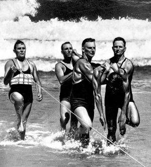 Bondi Surf Life Savers rescue a person during a surf carnival in the 1930s.