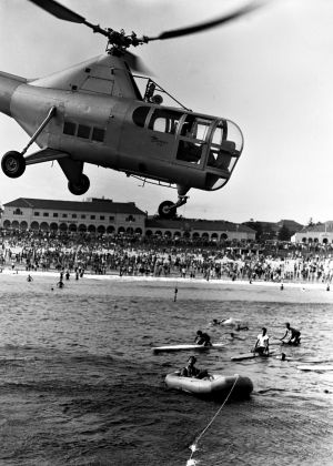 An RAAF helicopter in a rescue demonstration in 1948.
