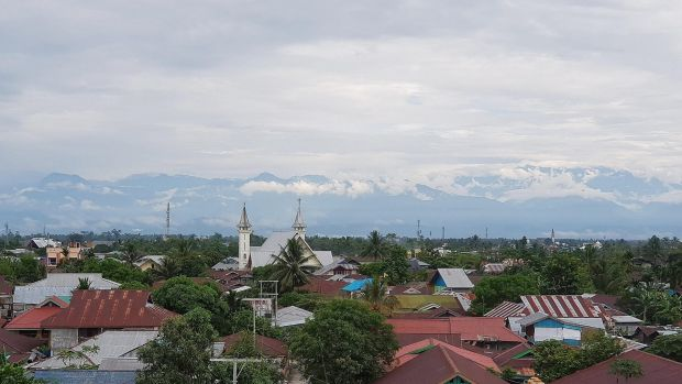 A wild, wild town: Timika with Nemangkawi Mountain in the background, where the Freeport mine is located.