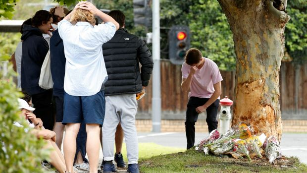 Class mates and friends visit the scene of the car crash in Malvern East.