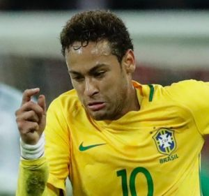 Brazil's Neymar takes the ball forward against England.