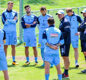 Talking point: Graham Arnold addresses the troops at Sydney FC training.