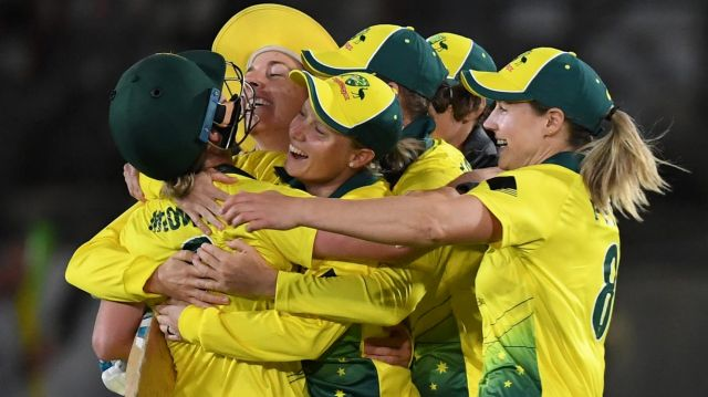 Breakthrough: Australia celebrate their win over England in the first Women's Ashes T20 match at North Sydney Oval.