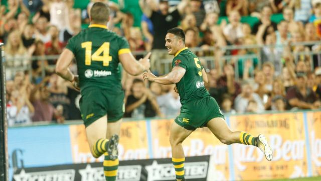 Unstoppable: Valentine Holmes races away for one of his record five tries against Samoa.