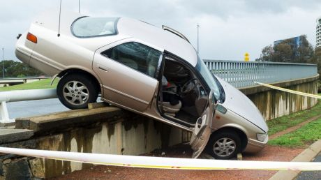 The car managed to wedge itself on the barrier of the Commonwealth Avenue on-ramp.