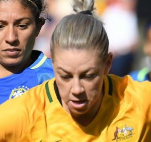 Australia's Alanna Kennedy (right) clears the ball against Brazil in their recent friendly in Sydney.