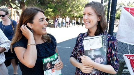 Greens candidate Lidia Thorpe and Labor candidate Clare Burns cross paths at Thornbury primary school on Saturday.