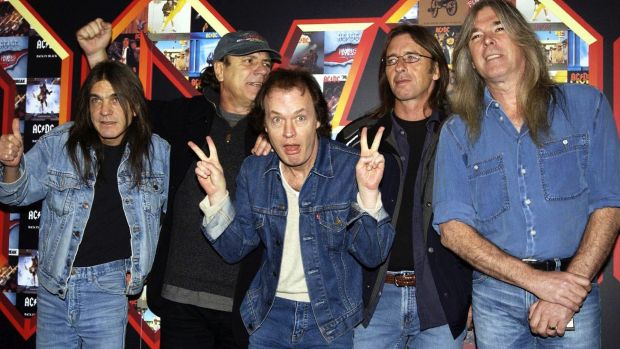 AC/DC's Malcolm Young (left) with Brian Johnson, Angus Young, Phil Rudd and Cliff Williams pose for photographers at the ...