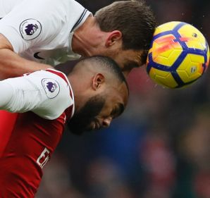 Over the top defending: Jan Vertonghen of Tottenham beats Alexandre Lacazette of Arsenal to the ball.