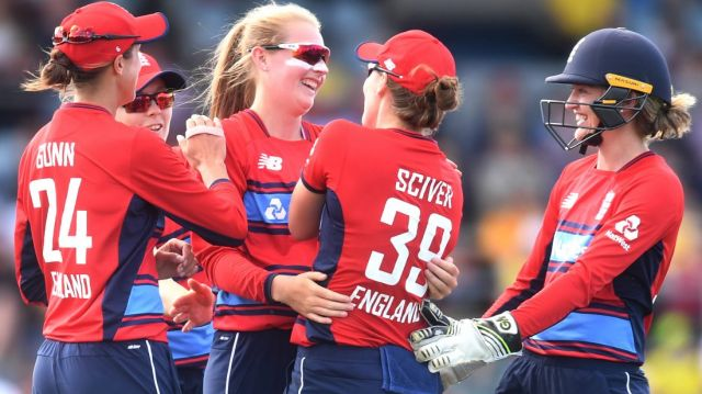 Sophie Ecclestone of England (centre) celebrates with teammates after claiming the wicket of Delissa Kimmince.
