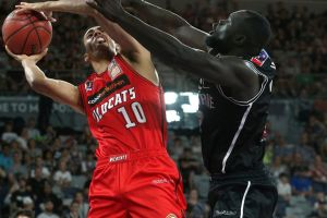 Drawing the foul: Perth's Dexter Kernich-Drew under pressure from Melbourne's Majok Majok.