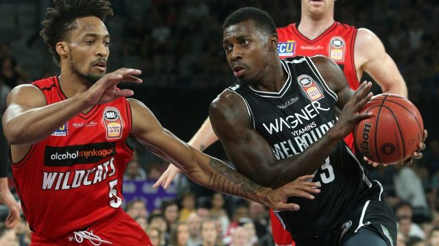 Driving run: United's Casey Prather of Melbourne takes on Jean-Pierre Tokoto of the Wildcats.