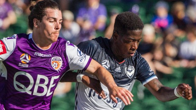 Victory's Leroy George takes on Glory defender Jeremy Walker at nib stadium in Perth.
