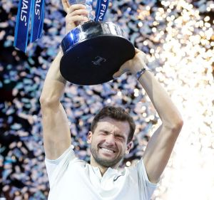 Grigor Dimitrov of Bulgaria lifts the trophy after defeating David Goffin of Belgium in London.