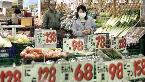Customers browse in the vegetable section at a Sankei Super, K.K. supermarket in Tokyo.