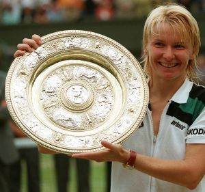 Jana Novotna displays the Wimbledon women's singles trophy after her victory over France's Nathalie Tauziat in the 1998 ...