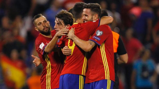 One to avoid: Spanish players celebrate after beating Albania 3-0 in October.