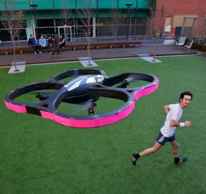 Chad Toprak, photographed with his jogging buddy, an autonomous robot drone helicopter.