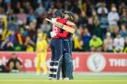 England's Katherine Brunt embraces Danielle Wyatt after Wyatt scored a remarkable century off 56 balls.