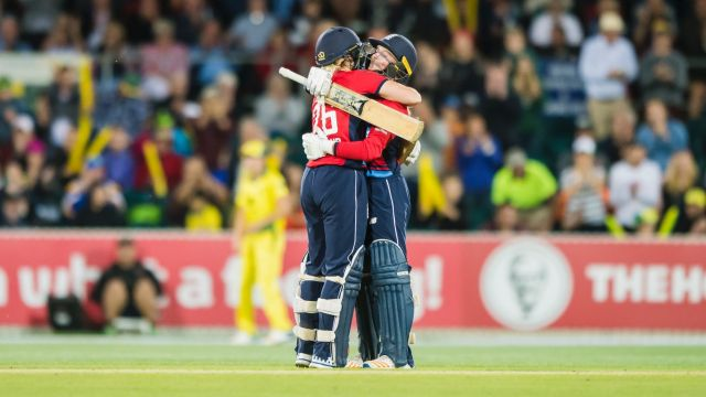 England's Katherine Brunt embraces Danielle Wyatt after Wyatt scored a century in the third T20 match at Manuka oval on ...