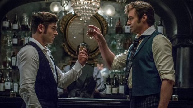 Zac Efron as Phillip Carlyle and Hugh Jackman as PT Barnum in The Greatest Showman.