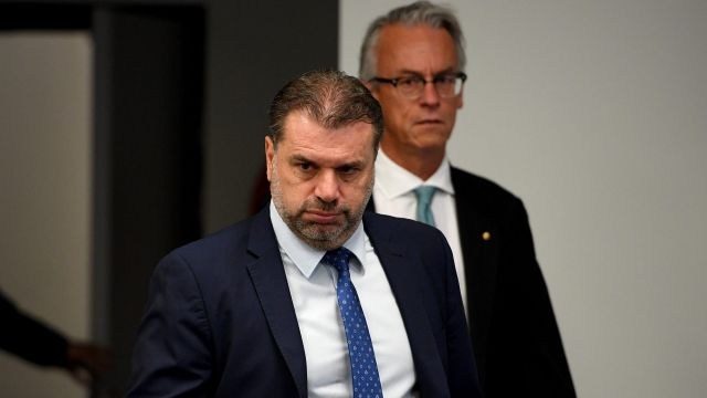 Ange Postecoglou and David Gallop arrive at the press conference on Wednesday.