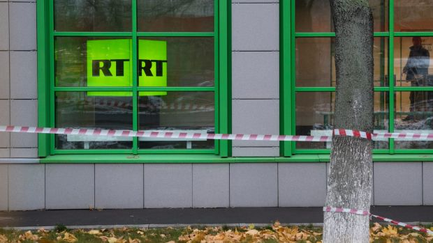 Russian state-owned television station RT logo is seen at the window of the company's office in Moscow.