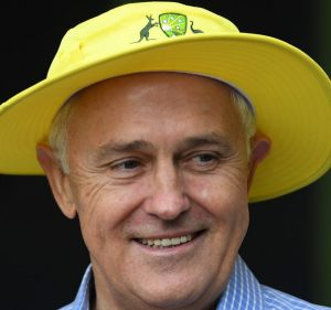 Prime Minister Malcolm Turnbull wears a yellow cricket hat as he receives members of the Australian Women's Cricket ...