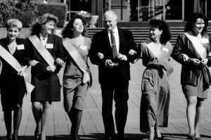 Beauty Queens. (19/4/91) the ACT Chief Minister Trevor kaine links arms with Queen of Canberra contestants (from left) ...