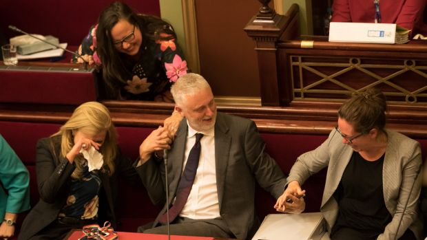 Reason Party MP Fiona Patten weeps and embraces Labor's Gavin Jennings as Jaclyn Symes takes his hand after the ...