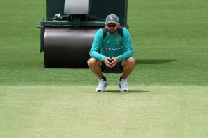 All set: Nathan Lyon inspects the pitch for the first Test.