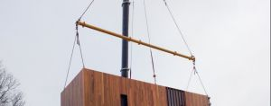 The lowering of a prefab classroom with a wooden exterior at Caulfield Grammar in Melbourne may be the future model for ...
