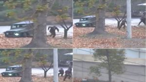 Surveillance video shows a North Korean soldier running from a jeep as he defects. He was later shot by North Korean ...