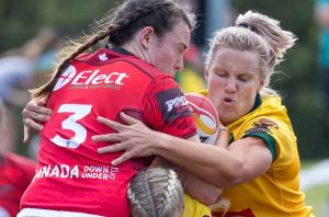 Renae Kunst of Australia has made a biting allegation against Janai Haupapa of Canada during this tackle on  Wednesday.