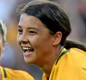 Sam Kerr (right) celebrates the first of her two goals against China at AAMI Park  on Wednesday night.