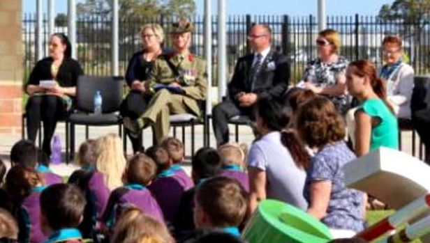 Barry Urban on Anzac Day wearing the fake medal at a school assembly.
