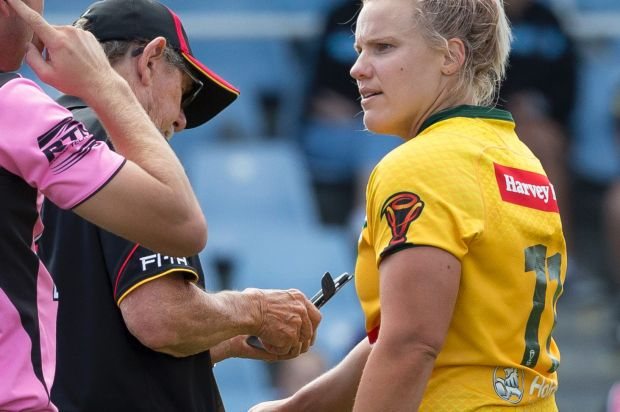 Renae Kunst of Australia (right) has her arm photographed by officials after alleging she was bitten in a tackle by ...