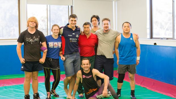 Canberra PCYC wrestling coach Witold Rejlich and athletes. The PCYC is celebrating its 60th birthday.