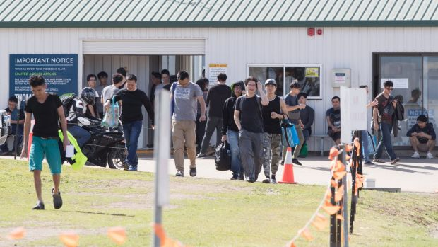 Workers leave the Thomas Foods meat processing plant after their shift finishes in Westdale, near Tamworth.