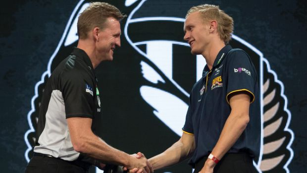 Jaidyn Stephenson meets his new coach, Collingwood's Nathan Buckley.