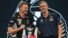 Jaidyn Stephenson is welcomed by Pies coach Nathan Buckley.